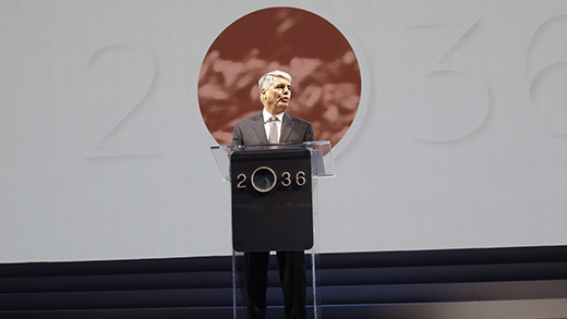 President Gregory L. Fenves speaks at a podium with the 2036 logo on it