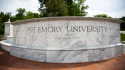 "A marble wall that says ""Emory University"""