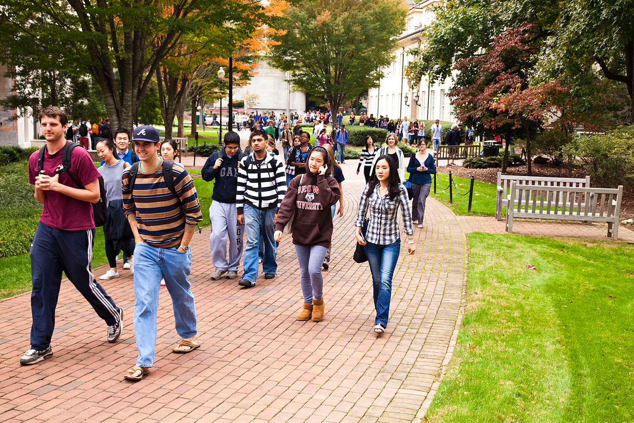 group of students walking outside on paths