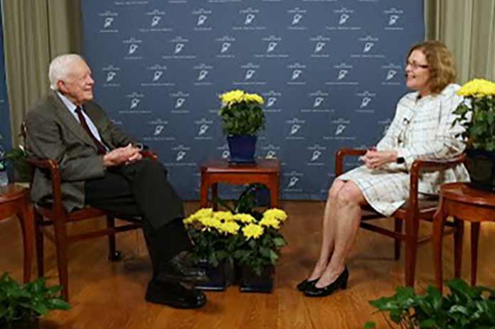 Claire Sterk conversing with Jimmy Carter