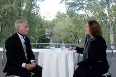 Claire Sterk conversing with Anthony Fauci