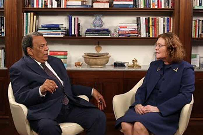 Claire Sterk conversing with Andrew Young