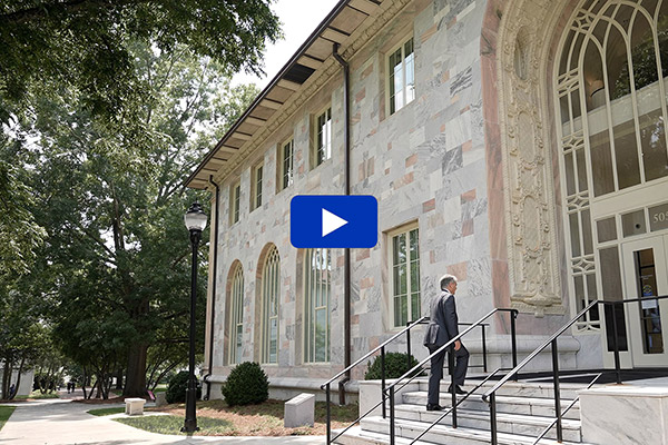 Emory President Gregory L. Fenves walks up the steps of Convocation Hall